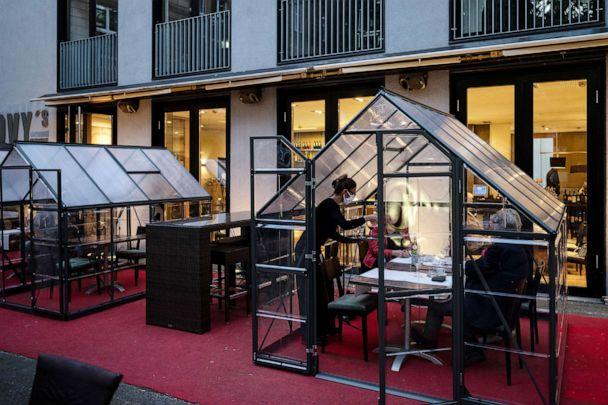 PHOTO: In 'Novy's Brasserie' guests are served at tables in small greenhouses, in Hagen, Germany, May 14, 2020. (Bernd Thissen/picture alliance via Getty Images)