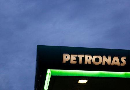 FILE PHOTO --  A logo of a Petronas fuel station is seen against a darkening sky in Kuala Lumpur