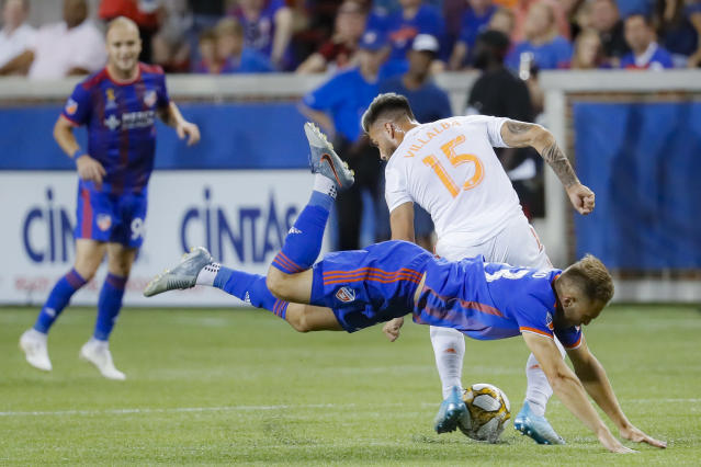 Atlanta United forward Hector Villalba (15) dribbles past FC Cincinnati midfielder Caleb Stanko (33) in the second half of an MLS soccer match, Wednesday, Sept. 18, 2019, in Cincinnati. (AP Photo/John Minchillo)
