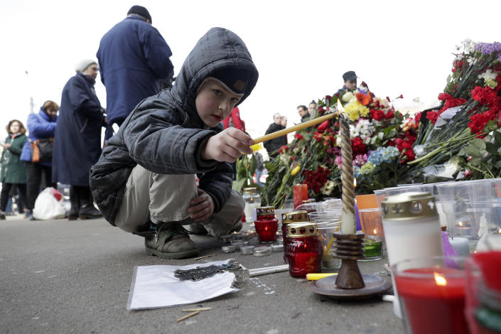 <p>A boy lights a candle at a symbolic memorial at Sennaya subway station in St. Petersburg, Russia, Tuesday, April 4, 2017. A bomb blast tore through a subway train deep under Russia's second-largest city St. Petersburg Monday, killing several people and wounding many more in a chaotic scene that left victims sprawled on a smoky platform. (Dmitri Lovetsky/AP) </p>