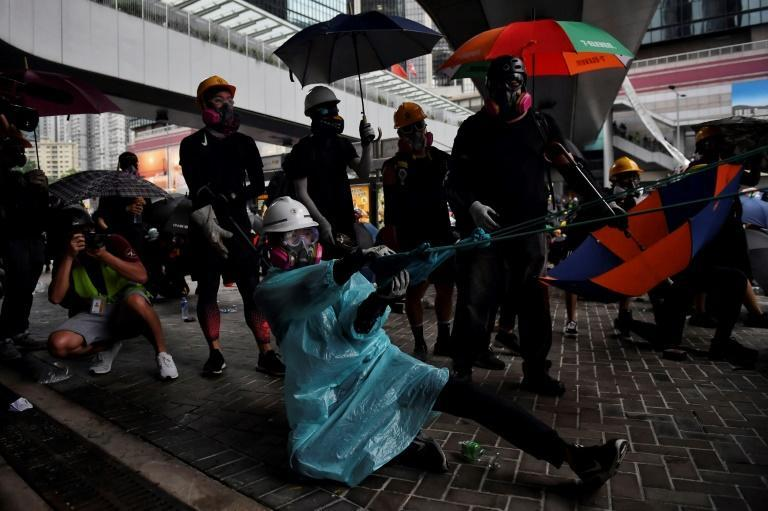 This protester outside of Hong Kong's Legislative Council uses an extra-strength slingshot to launch a brick