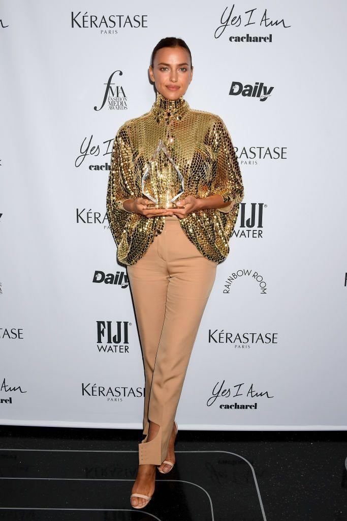 <p><strong>9 September</strong></p><p>Irina Shayk teamed a very sparkly gold top with nude trousers by Burberry as she picked up an award.</p>