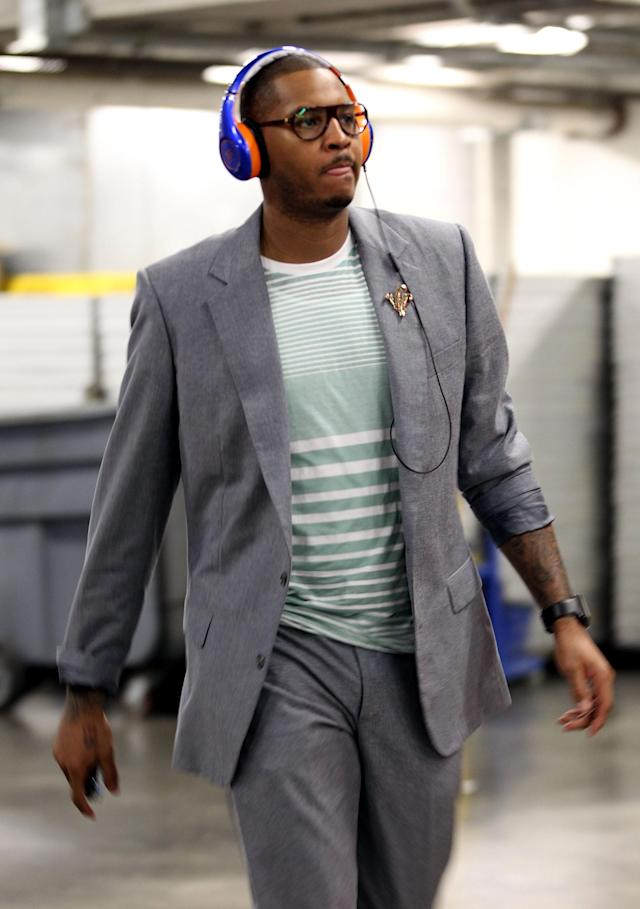 MIAMI, FL - MAY 09: Carmelo Anthony of the New York Knicks enters the arena prior to his team taking on the Miami Heat in Game Five of the Eastern Conference Quarterfinals in the 2012 NBA Playoffs on May 9, 2012 at the American Airines Arena in Miami, Florida. NOTE TO USER: User expressly acknowledges and agrees that, by downloading and or using this photograph, User is consenting to the terms and conditions of the Getty Images License Agreement. (Photo by Marc Serota/Getty Images)
