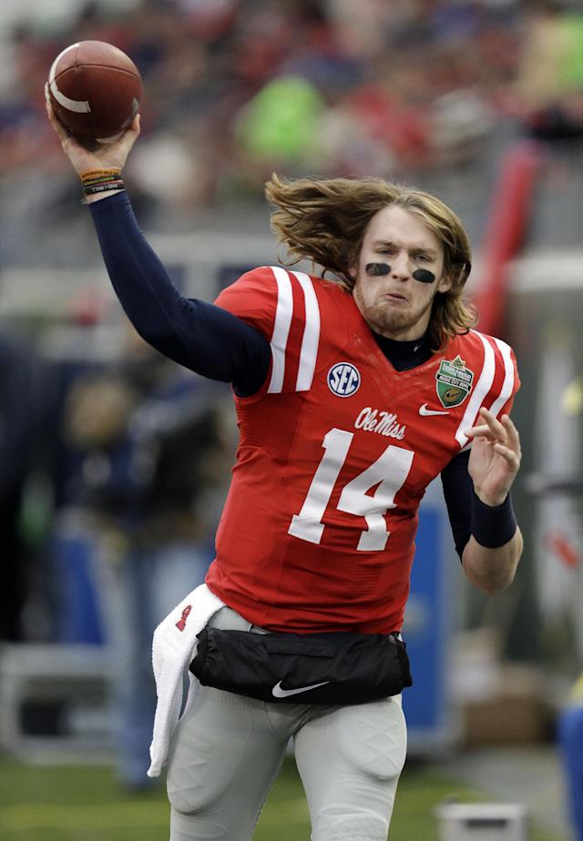 Mississippi quarterback Bo Wallace warms up on the sideline before going back into the game in the first quarter of the NCAA college football Music City Bowl against Georgia Tech on Monday, Dec. 30, 2013, in Nashville, Tenn. (AP Photo/Mark Humphrey)
