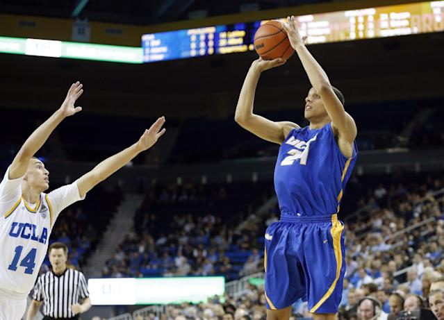 UC Santa Barbara's Michael Bryson, right, makes a three pointer over UCLA's Zach LaVine, left, during the first half of an NCAA college basketball game, Tuesday, Dec. 3, 2013, in Los Angeles. (AP Photo/Danny Moloshok)