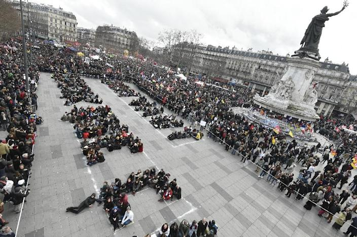"French green political party Europe Ecology - The Greens (EELV) militants gather in place de la Republique on March 9, 2016, to write ""We are worth more than this"" on the pavement with their bodies (AFP Photo/Dominique Faget)"