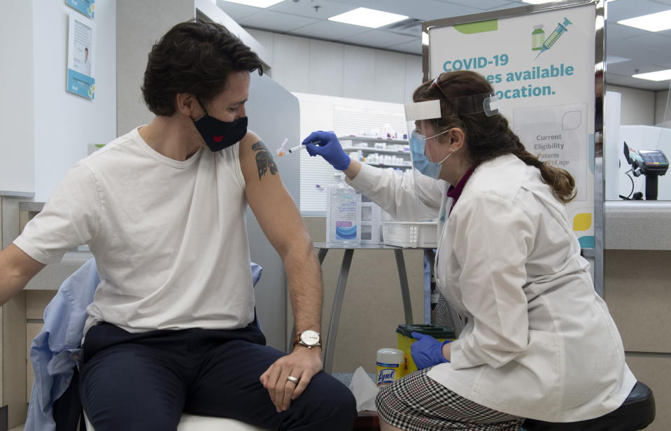 Prime Minister Justin Trudeau receives his first COVID vaccination in Ottawa, Friday April 23, 2021. (Adrian Wyld/The Canadian Press via AP)