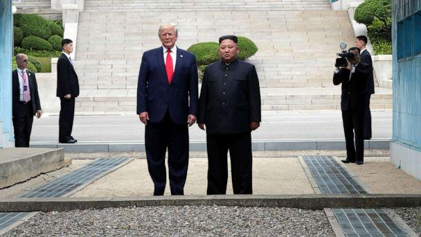 PHOTO: A handout photo provided by Dong-A Ilbo of North Korean leader Kim Jong Un and U.S. President Donald Trump inside the demilitarized zone (DMZ) separating the South and North Korea on June 30, 2019 in Panmunjom, South Korea. (Handout/Getty Images)