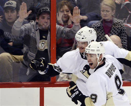 Pittsburgh Penguins' Dustin Jeffrey (17) celebrates a goal against the Ottawa Senators with Pascal Dupuis (9) during the first period of their NHL hockey game in Ottawa, Ontario, Monday, April 22, 2013. (AP Photo/The Canadian Press, Justin Tang)