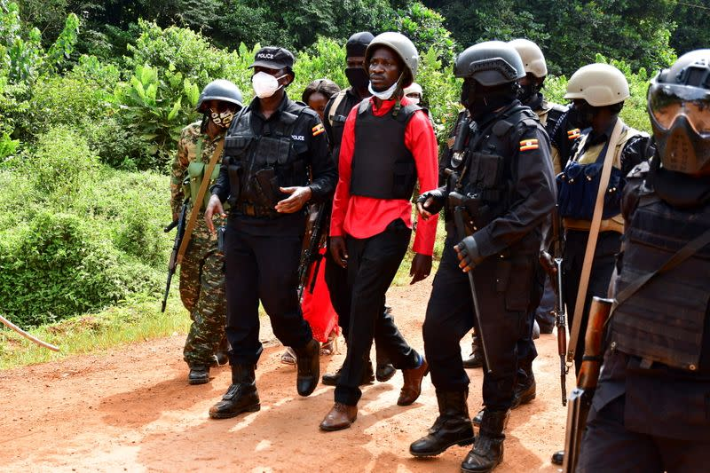 Uganda opposition presidential candidate Robert Kyagulanyi is escorted by police in Kalangala