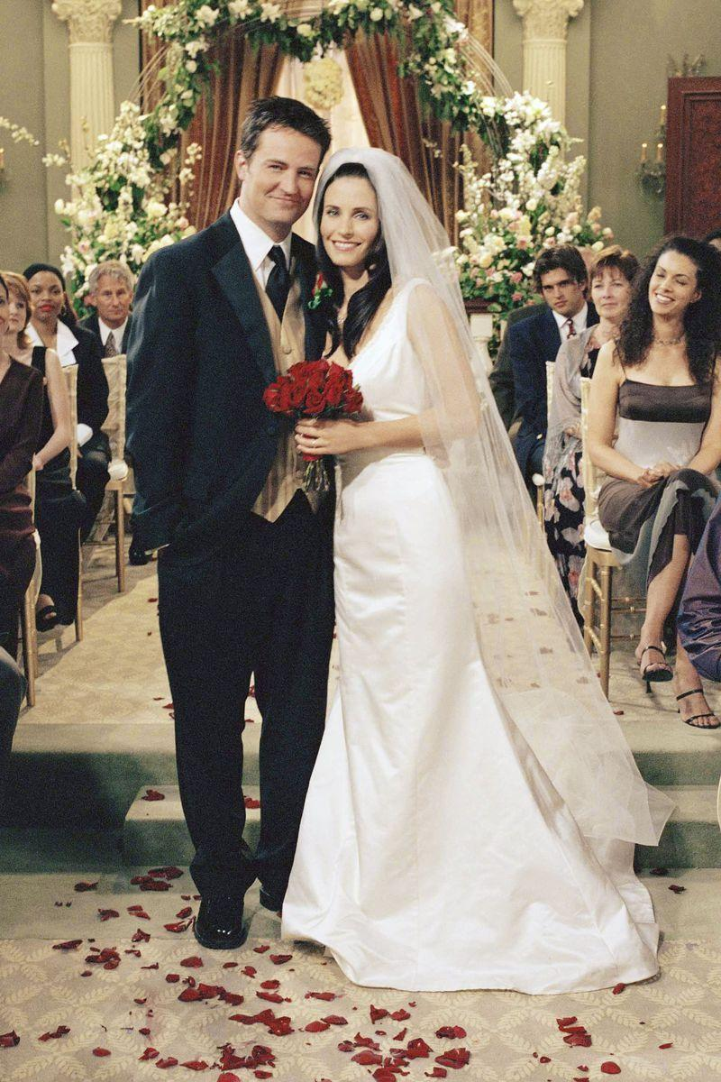<p>Monica and Chandler finally tied the knot in season 7 of <em>Friends, </em>and Monica wore this plunging V-neck dress with a trumpet skirt and a long veil. The episode in which they try to write down their wedding vows for the big day showed so many adorable flashback scenes of their relationship, it was hard not to ugly sob. </p>