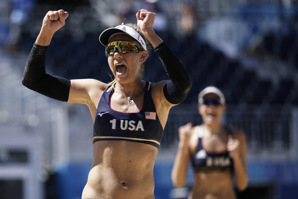 April Ross, left, of the United States, and teammate Alix Klineman celebrate winning a women's beach volleyball semifinal match against Switzerland at the 2020 Summer Olympics, Thursday, Aug. 5, 2021, in Tokyo, Japan. (AP Photo/Felipe Dana)