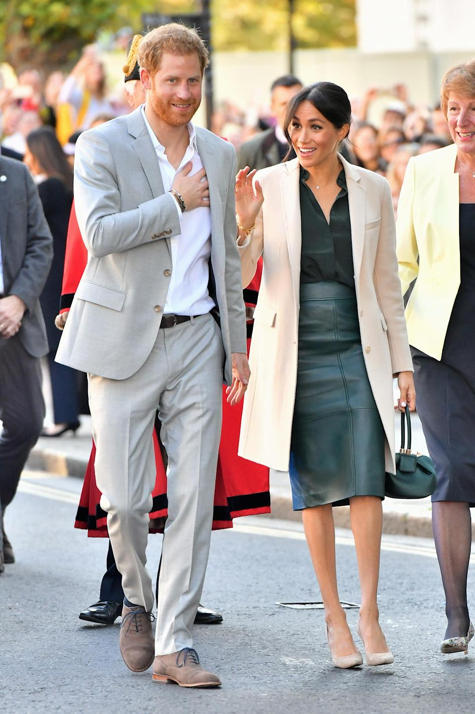<p>The Duchess visited Sussex for the first time in one expensive look. Meghan teamed a £1695 Gabriela Hearst bag with a BOSS leather skirt, an Armani coat and a blouse from Swedish high street label & Other Stories – which sold out almost instantly. <em>[Photo: Getty]</em> </p>