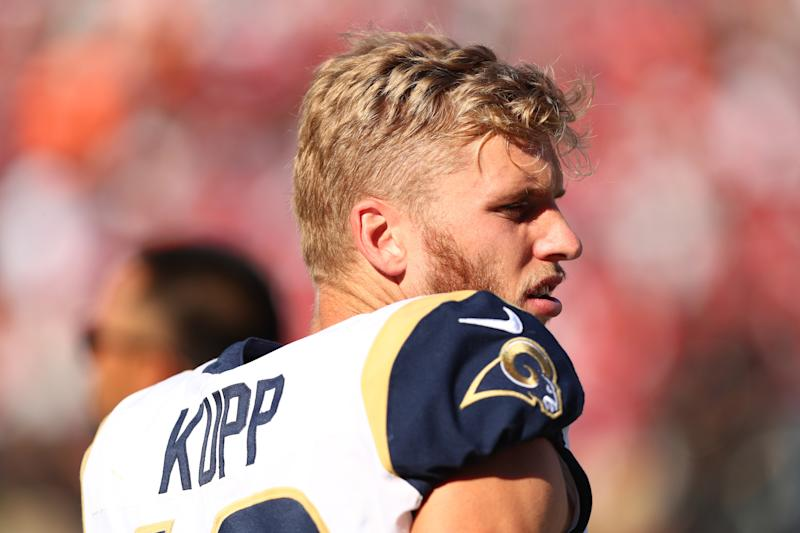 LOS ANGELES, CALIFORNIA - OCTOBER 13: Cooper Kupp #18 of the Los Angeles Rams looks on from the bench in the fourth quarter against the San Francisco 49ers at Los Angeles Memorial Coliseum on October 13, 2019 in Los Angeles, California. (Photo by Joe Scarnici/Getty Images)