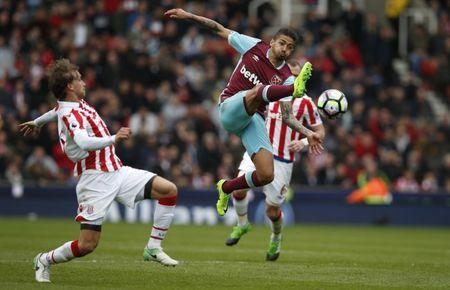 West Ham United's Manuel Lanzini in action with Stoke City's Marc Muniesa