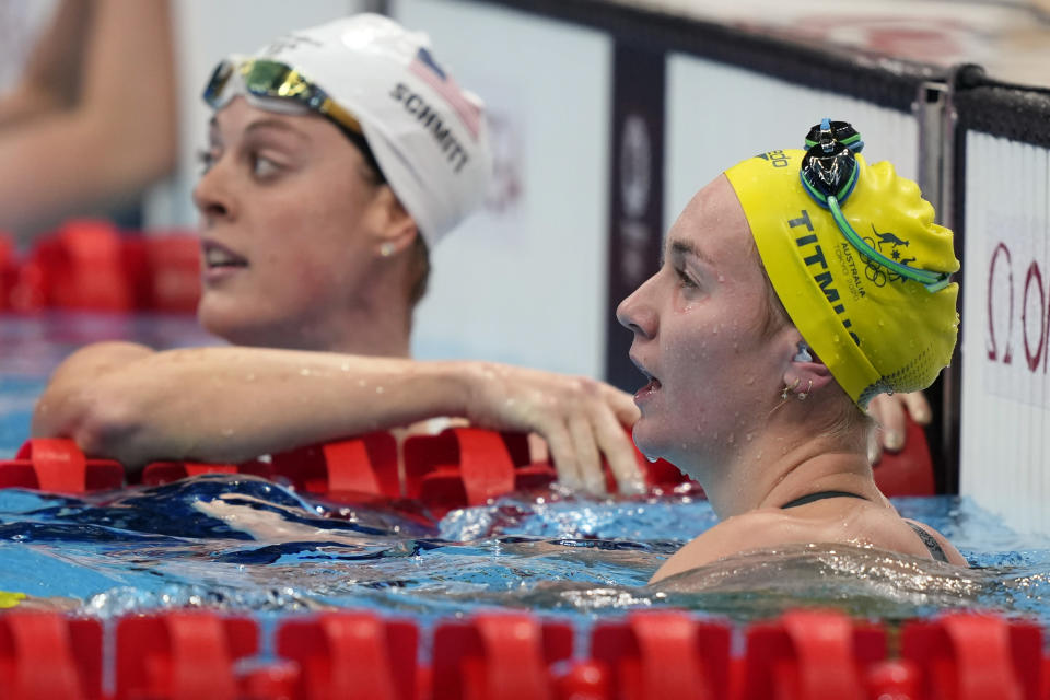 Ariarne Titmus of Australia rests after her heat in the women's 200-meter freestyle at the 2020 Summer Olympics, Monday, July 26, 2021, in Tokyo, Japan. (AP Photo/Martin Meissner)