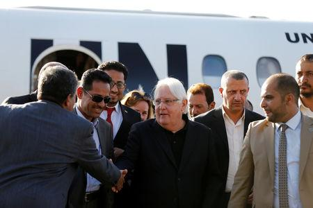 United Nations envoy to Yemen, Martin Griffiths, shakes hands with Houthi officials upon his arrival at Sanaa airport in Sanaa, Yemen