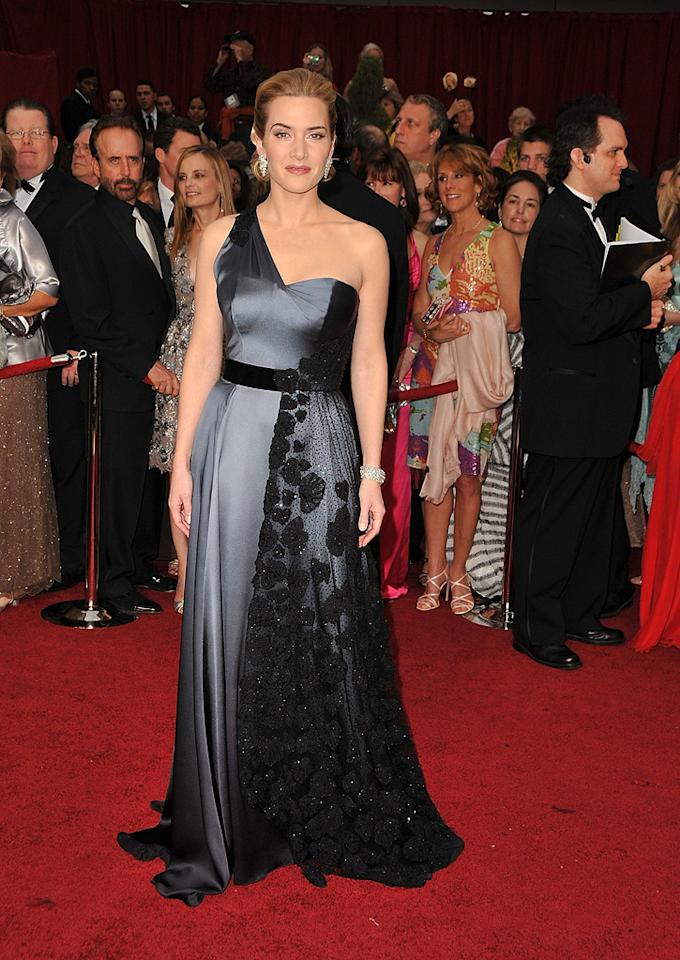Kate Winslet   Grade: B+       The Best Actress winner also won rave reviews for her stunning one-shoulder Yves St. Laurent gown, Chopard jewels, and classy 'do.