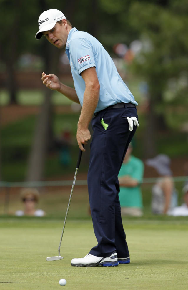 Nick Watney watches a shot on the 16th green during the second round of the Wells Fargo Championship golf tournament at Quail Hollow Club in Charlotte, N.C., Friday, May 4, 2012. (AP Photo/Gerry Broome)