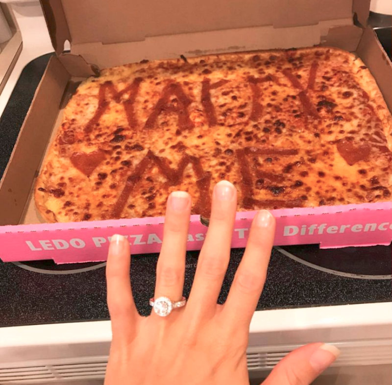 One man used pizza to propose. Photo: Facebook