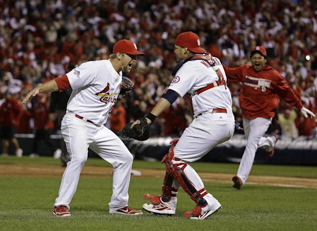 St. Louis Cardinals catcher Yadier Molina and Trevor Rosenthal celebrate after Game 6 of the National League baseball championship series against the Los Angeles Dodgers Friday, Oct. 18, 2013, in St. Louis. The Cardinals won 9-0 to win the series. (AP Photo/David J. Phillip)