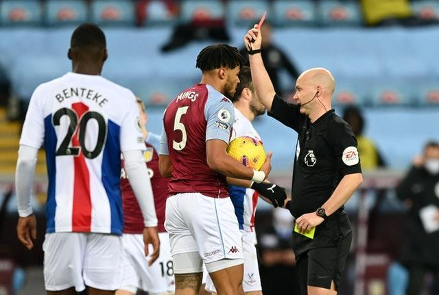Aston Villa's Tyrone Mings is shown a red card