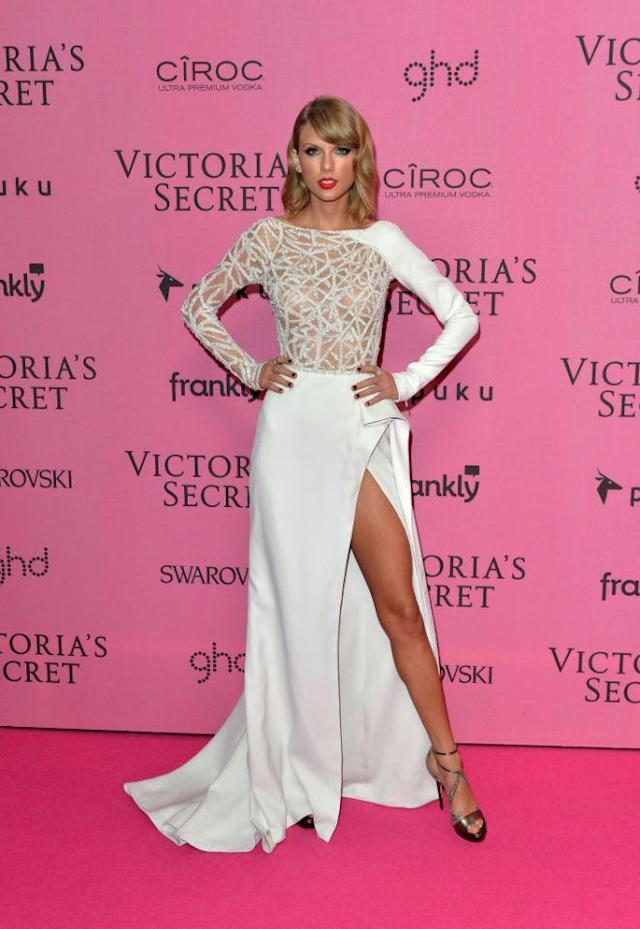 <p>When the singer lent her vocal talents to the 2014 Victoria's Secret Fashion Show, she did her best to make sure she fit in with the ladies, many of whom are part of her squad. Not only did she opt for see-through ensembles when she was onstage, but she also showed off almost all of her model-long leg on the pink carpet. (Photo: Getty Images) </p>