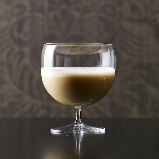 "<p>This creamy, spiced drink honors an Irish Halloween bread called barm brack, which is filled with <a href=""https://editor.foodandwine.com/fruits/berries/currant-recipes"" target=""_blank"">currants</a> and raisins. Traditionally, various objects—a coin, a ring, a pea—were baked inside the loaf as a kind of fortune-telling game. We love the nutmeg notes for fall and we think you will, too.</p><p><a href=""https://www.foodandwine.com/recipes/barm-brack"">GO TO RECIPE</a></p>"