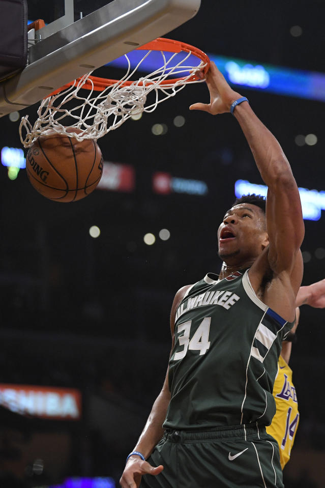 Milwaukee Bucks forward Giannis Antetokounmpo dunks during the first half of an NBA basketball game against the Los Angeles Lakers Friday, March 6, 2020, in Los Angeles. (AP Photo/Mark J. Terrill)