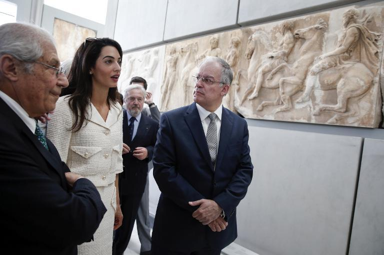 British lawyers advising Greece on how to secure the return of the Parthenon Marbles from Britain, including Amal Alamuddin Clooney, visit the Parthenon hall in Athens, accompanied by the museum director and Greek officials on October 15, 2014