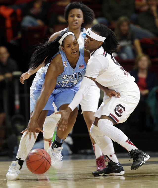 North Carolina forward Xylina McDaniel (34), left, collides with South Carolina guard Khadijah Sessions during the first half of a regional semifinal at the NCAA college basketball tournament in Stanford, Calif., Sunday, March 30, 2014. (AP Photo/Marcio Jose Sanchez)