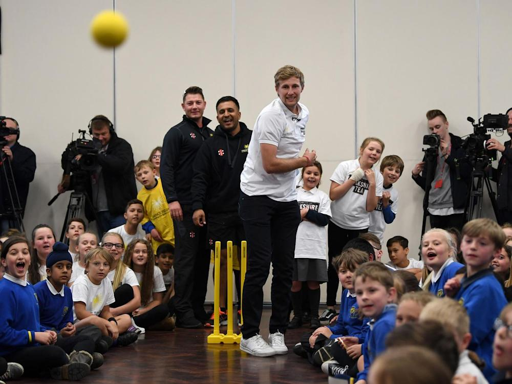 Root treats the children of his old primary school to some of his bowling (Getty)