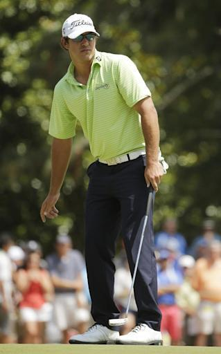 Brooks Koepka reacts after missing a putt on the first hole during the third round of the U.S. Open golf tournament in Pinehurst, N.C., Saturday, June 14, 2014. (AP Photo/Chuck Burton)