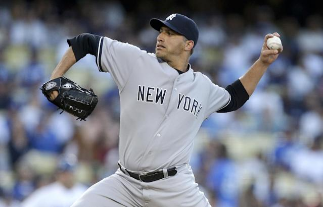 New York Yankees starting pitcher Andy Pettitte throws to the Los Angeles Dodgers during first inning of a baseball game in Los Angeles, Tuesday, July 30, 2013. (AP Photo/Chris Carlson)