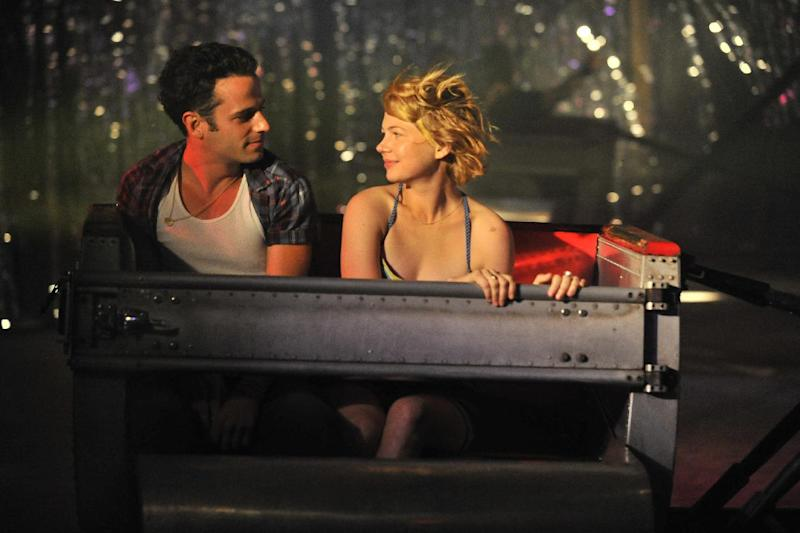 """This film image released by Magnolia Pictures shows Luke Kirby, left, and Michelle Williams in a scene from """"Take This Waltz."""" (AP Photo/Magnolia Pictures)"""
