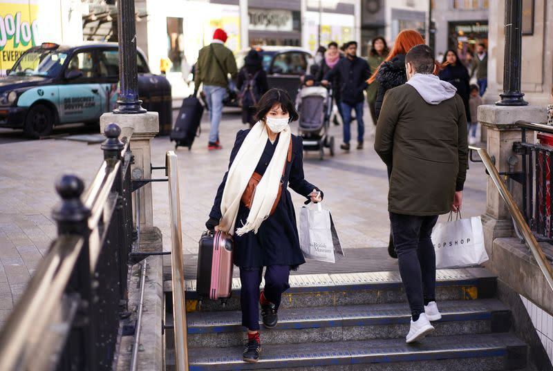 A woman wears a protective face mask in central London