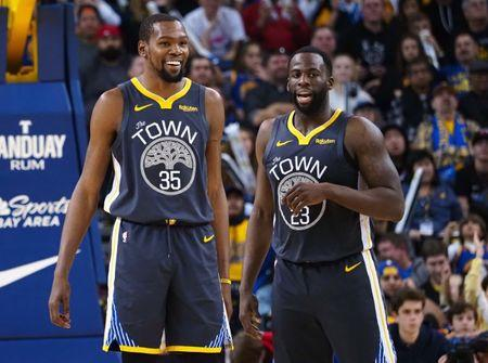 Feb 10, 2019; Oakland, CA, USA; Golden State Warriors forward Kevin Durant (35) smiles with forward Draymond Green (23) after a play against the Miami Heat during the fourth quarter at Oracle Arena. Mandatory Credit: Kelley L Cox-USA TODAY Sports