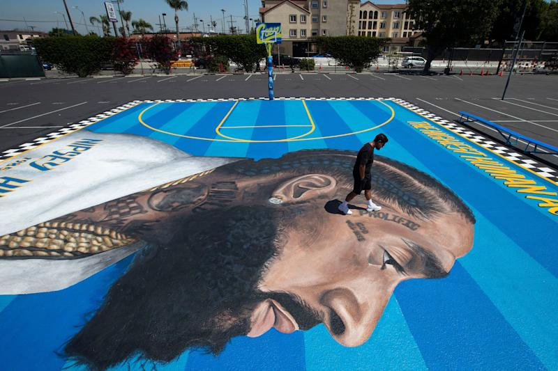 A basketball court mural in honor of Nipsey Hussle by Gustavo Zermeno Jr., April 2019