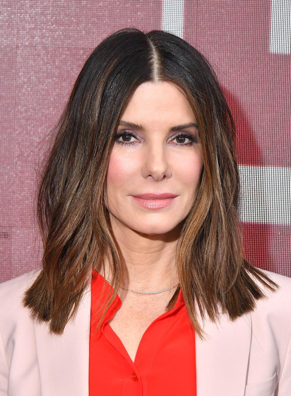 Sandra Bullock was a surprise guest on a 'Red Table Talk' episode honoring 'hero mothers' on the frontline against coronavirus.