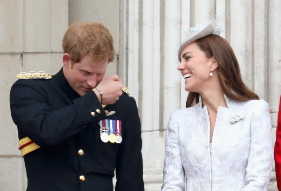 Harry makes Kate laugh as they hang out on the balcony during Trooping the Colour at The Royal Horseguards in June 2014 in London. (PA Images)