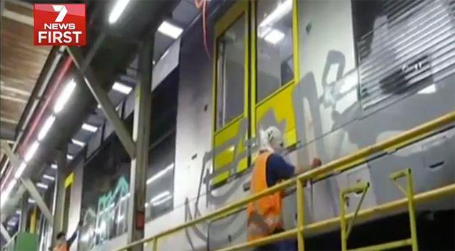 Two vandals dress as train network employees. Image: 7News