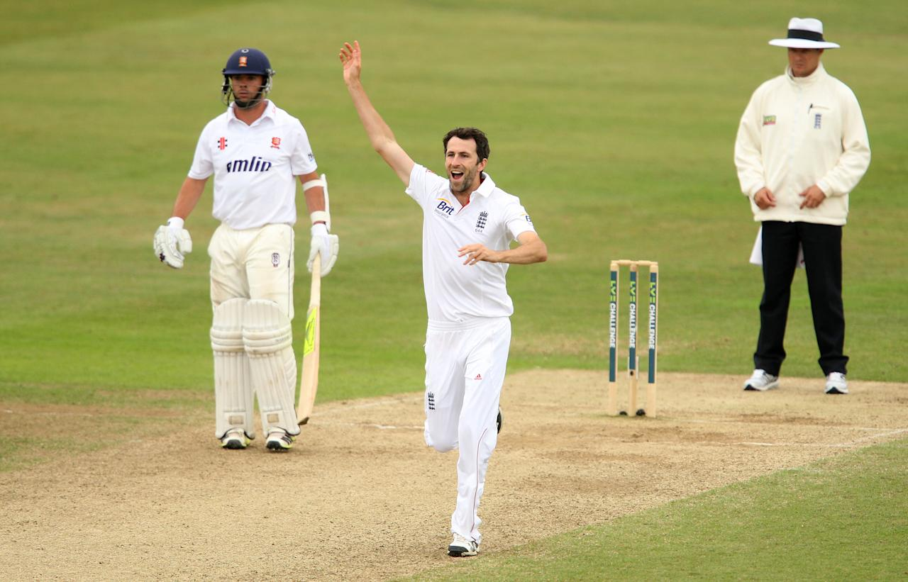 England's Graham Onions celebrates taking a wicket during day four of the International Tour match at The County Ground, Chelmsford.