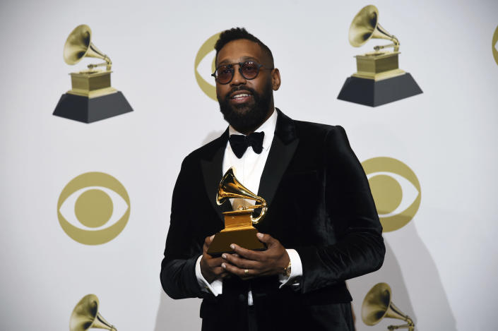 """FILE - In this Sunday, Jan. 26, 2020 file photo, PJ Morton poses in the press room with the award for best R&B song for """"Say So"""" at the 62nd annual Grammy Awards at the Staples Center in Los Angeles. A New Orleans high school is celebrating Grammy nominations for four of its graduates. St. Augustine High School alumni PJ Morton, Timothy Thedford, Jonathan Batiste and Luke James are each up for best album in different categories at the awards show Sunday, March 14, 2021.(AP Photo/Chris Pizzello, File)"""