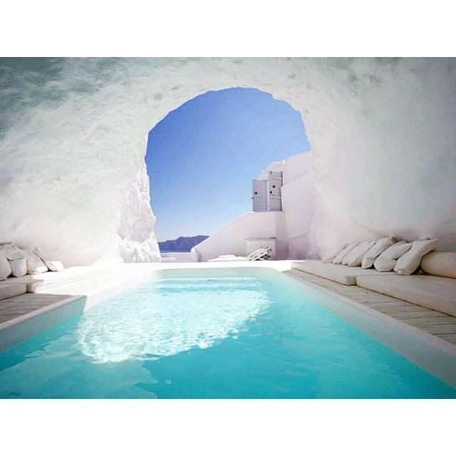 <p>This Greek hotel pool boasts crystal-clear water and views of the sea from the confines of a white concrete cave. </p>