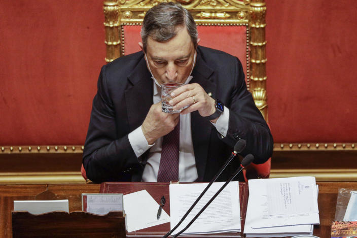 """Italian Premier Minister Mario Draghi sips water at the end of his address at the Senate in Rome, Tuesday, April 27, 2021. Italian Premier Mario Draghi is presenting a 222.1 billion euro ($268.6 billion) coronavirus recovery plan to the Seante. The plan is aiming to not only bounce back from the pandemic but enact """"epochal"""" reforms to address structural problems that long predated COVID-19.(AP Photo/Gregorio Borgia, Pool)"""