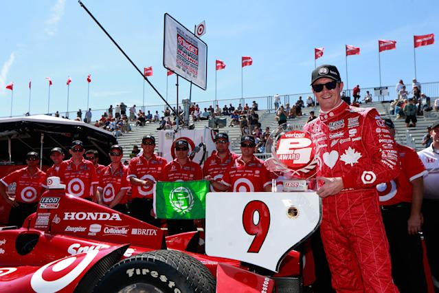TORONTO, ON - JULY 13: Scott Dixon of New Zealand, driver of the #9 Target Chip Ganassi Racing Honda poses with the Verizon P1 Pole Award following qualifying for the IZOD INDYCAR Series Honda Indy Toronto Race #2 on July 13, 2013 in Toronto, Canada. (Photo by Chris Trotman/Getty Images)