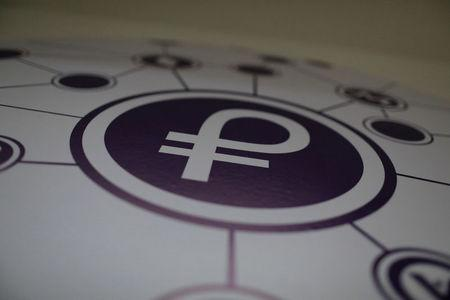"""The new Venezuelan cryptocurrency """"Petro"""" logo is seen at a facility of the Youth and Sports Ministry in Caracas, Venezuela February 23, 2018. REUTERS/Marco Bello"""
