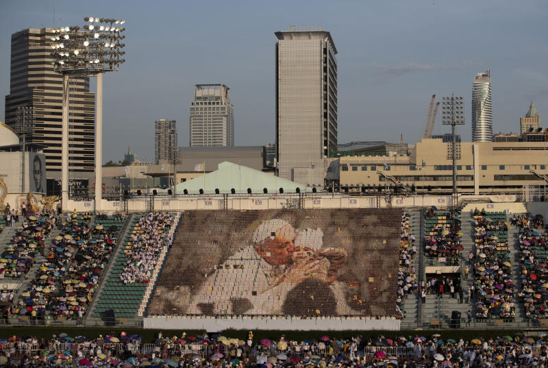 Students practice flipping boards with photos to reveal a full-mosaic portrait of Pope Francis before a Holy Mass at National Stadium in Bangkok, Thailand, Thursday, Nov. 21, 2019.(AP Photo/Sakchai Lalit)