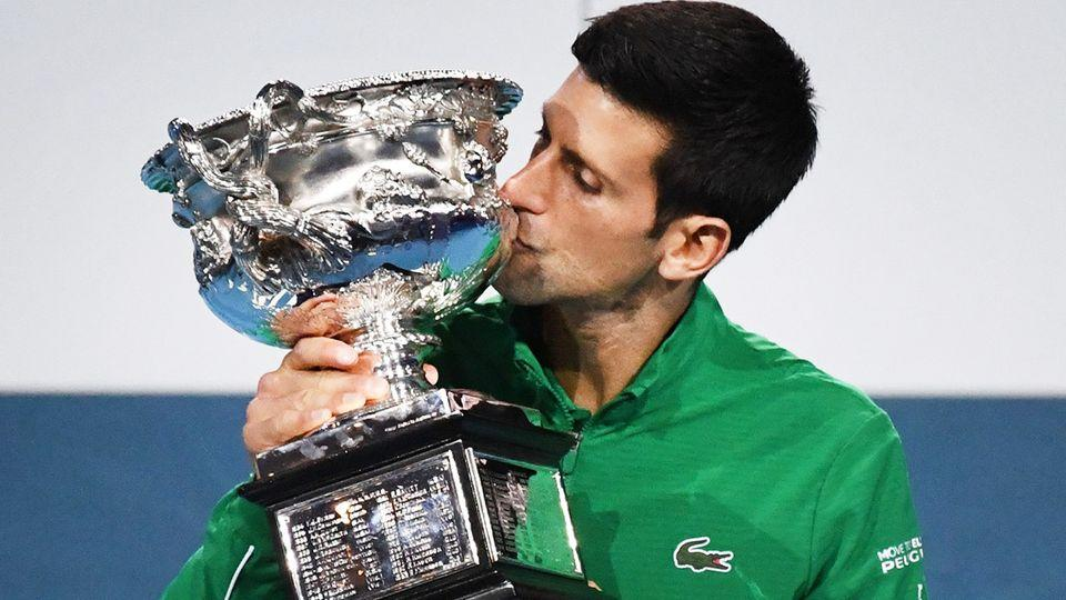 Seen here, 2020 Australian Open champion Novak Djokovic with his winner's trophy.