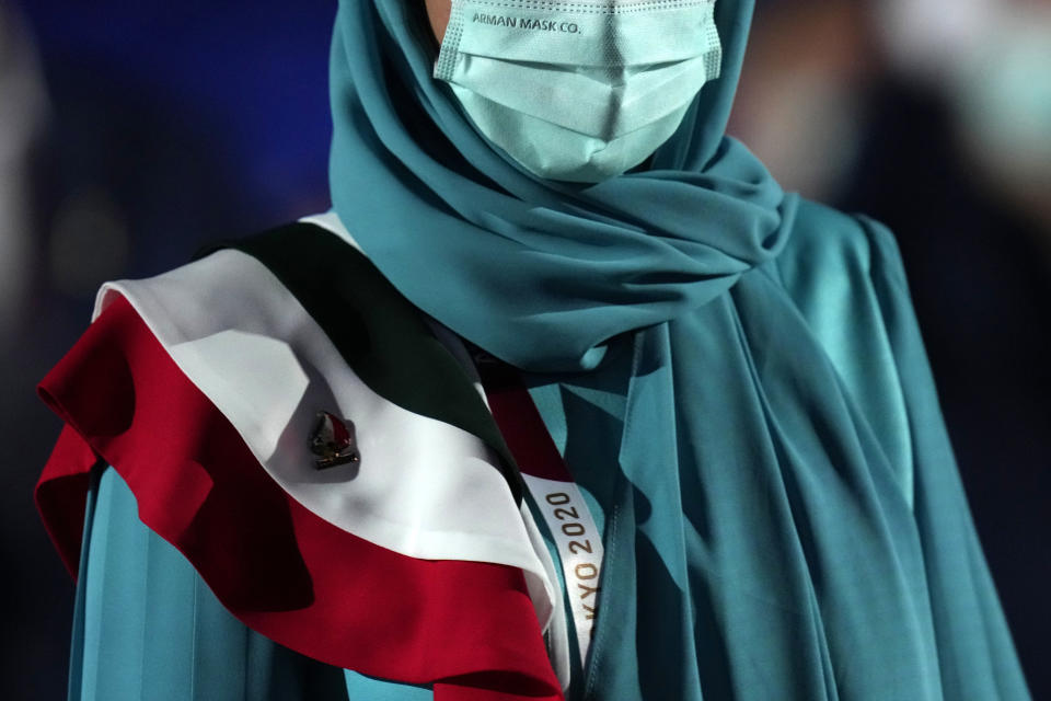 Team member of Iran walks during the opening ceremony inside the Olympic Stadium at the 2020 Summer Olympics, Friday, July 23, 2021, in Tokyo, Japan. (AP Photo/Petr David Josek)
